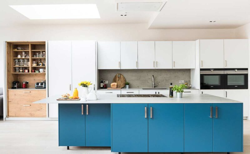 designer modular kitchen with island and multiple drawers and shelves using complete hafele blum fittings