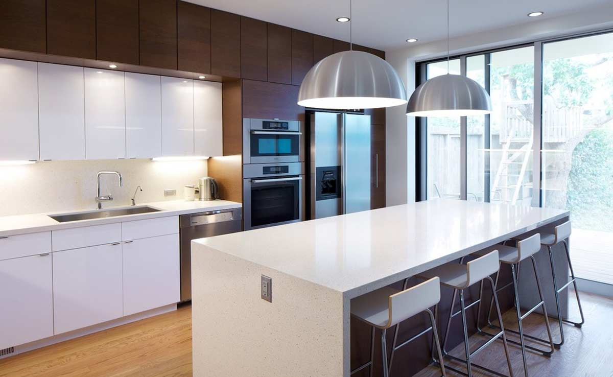 modular kitchen with island and dining area in gurgaon and delhi