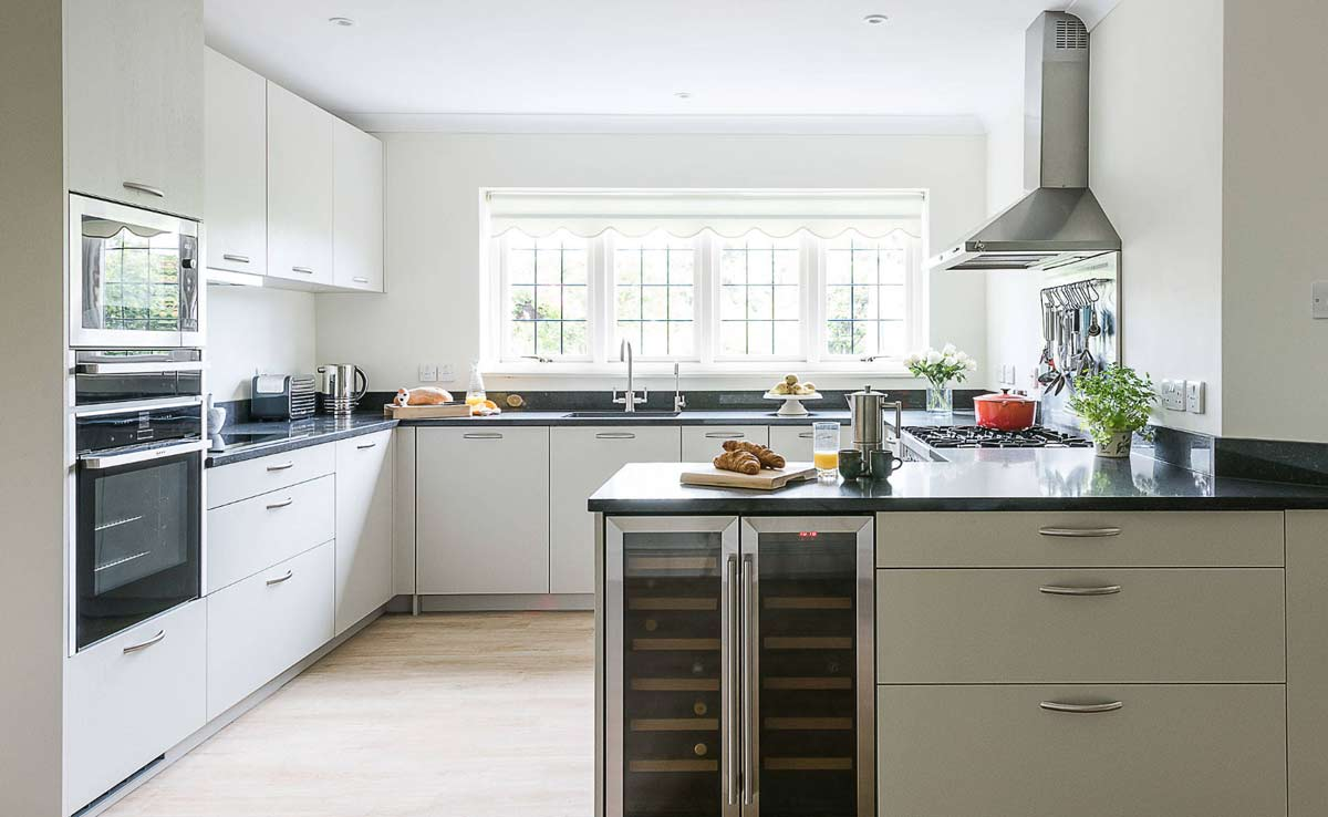 we provide beautiful designer modular kitchen with inbuilts and inbuilt bar cabinets and wine chiller