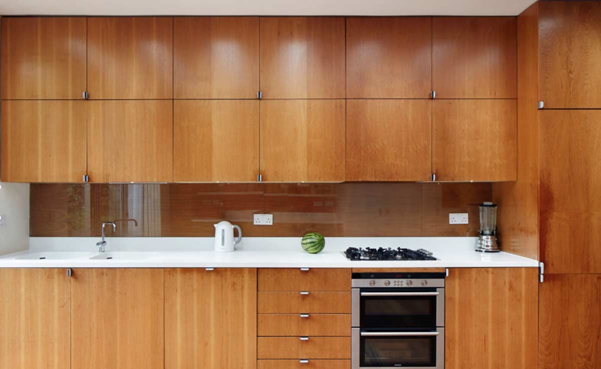 brown modular kitchen cabinets till roof installed in gurgaon