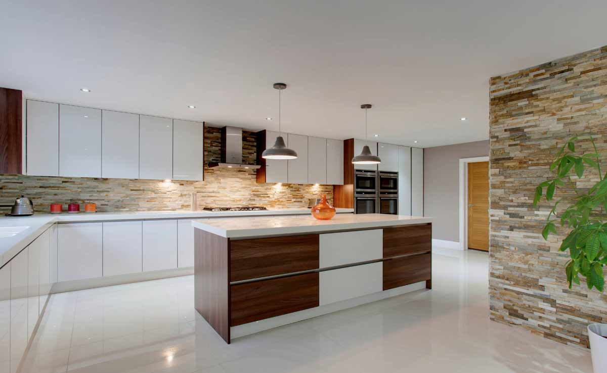 modular kitchen with long wooden island and hafele fittings