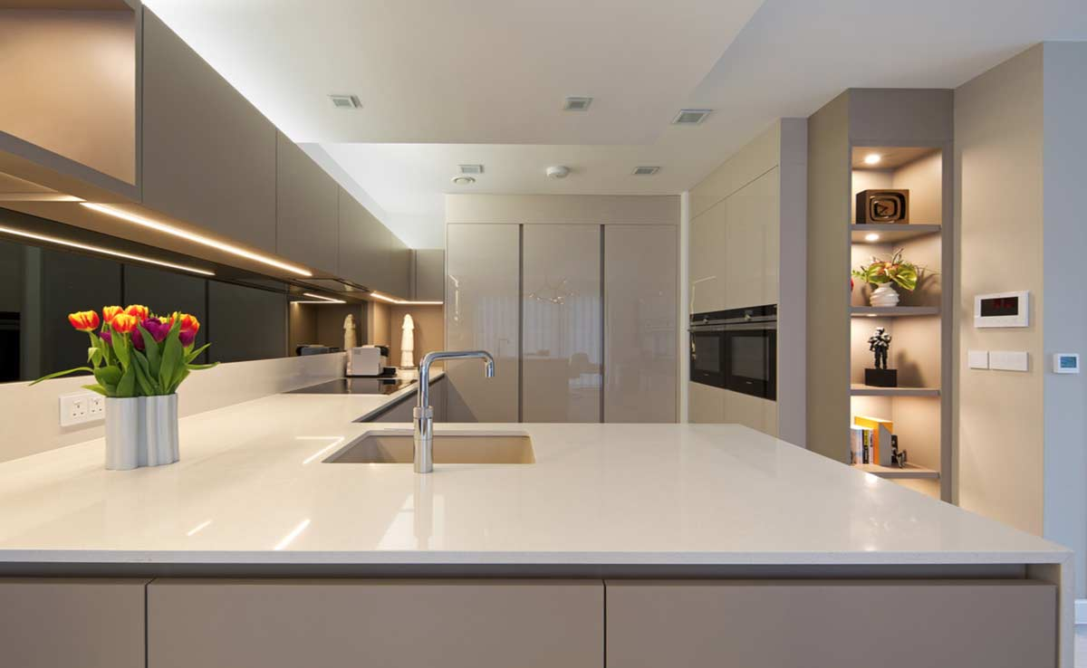 long modular kitchen extensions with crockery units and inbuilt lights and corian counter top and acrylic shutters