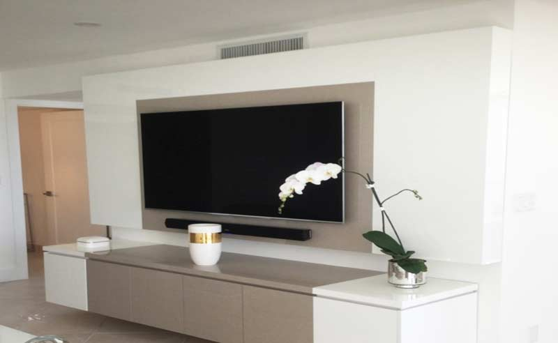 designer tv units with acrylics and base cabinet storage