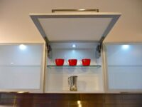 servo drive automatic fitting by blum installed by design indian kitchen company gurgaon and delhi