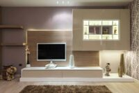 gorgeous tv unit with ample storage and a contemporary design with acrylics and laminates and lot of internal lights