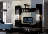 a brillant tv unit in black with lacquer glass and clear glass combination with top shelves for books