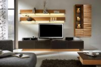 a minimalistic tv unit with extensive inbuilt lights and wall panelling