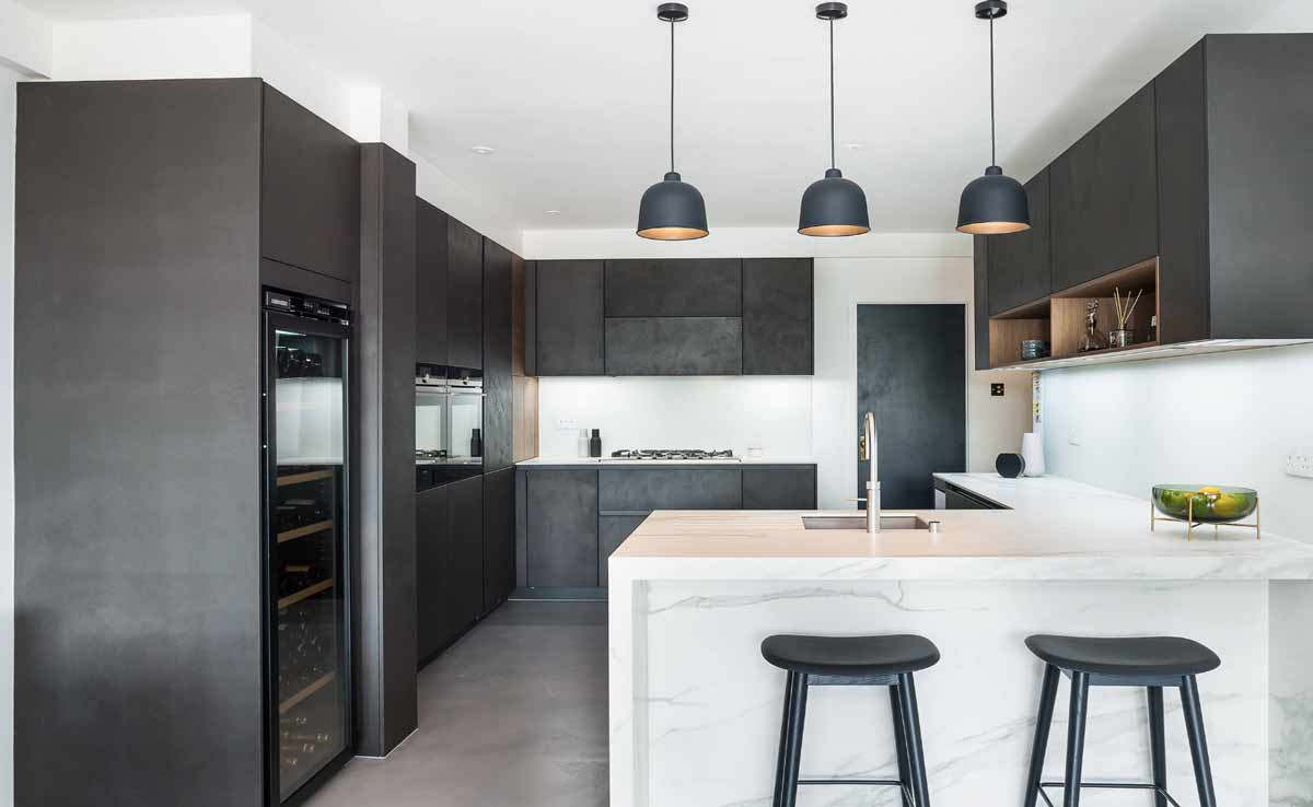 a modular kitchen with quartz countertop and black kitchen shutters manufactured in gurgaon and delhi