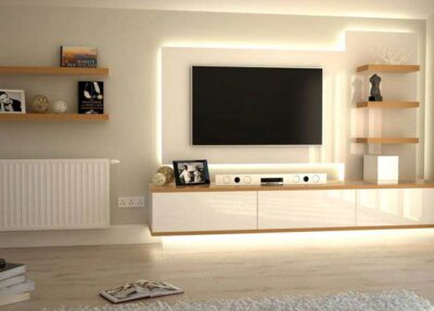 tv unit with backlight lit and multiple shelfs and in white acrylics