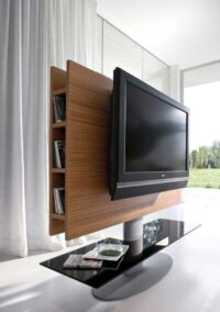 a well designed tv uit with stand and back storage for ample space and a lacquer glass bottom shelf