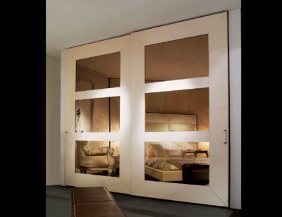 overlapping glass wardrobe fitting by hafele installed by the design indian wardrobe company