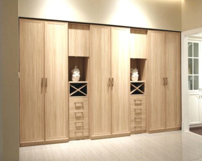 teak board polished wardrobe by the design indian wardrobe company