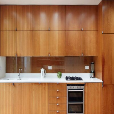 modular kitchen with veneer shutters and inbuilt microwave and oven installed in gurgaon